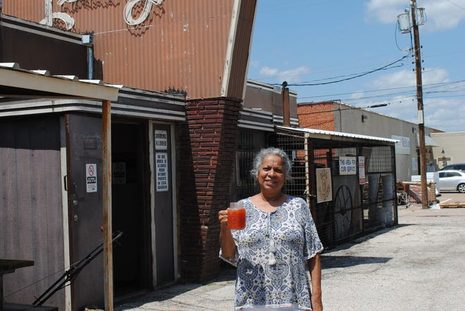 Ester Whitley, Bar L manager is seen Wednesday with one of their famous Red Draws. The drink is beer and tomato juice.