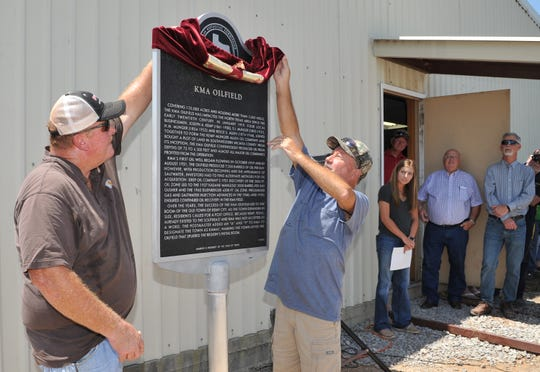 Jeff Crenshaw and Barry Phillips unveiled the KMA Oilfield historical marker during a ceremony held Wednesday afternoon at the Kamay volunteer fire department.