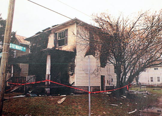 An evidence photograph of 1848 Ridge Ave. The house had been set on fire to to cover up evidence in the murder of Kylee Lindell. The house has seen been torn down.