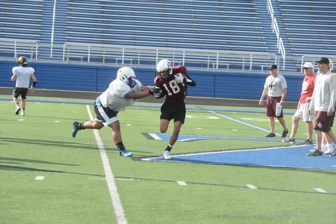 Zanesville's Jeremiah Hollins tries to corral John Glenn's Joseph Clifford during Tuesday's Muskingum Valley All-Star practice. Muskingum and Licking Valley kick off the 38th edition of the all-star game at 7 p.m. Friday at Sheridan.