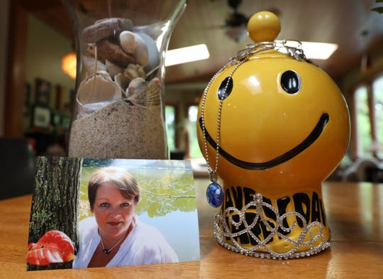 The ashes of longtime columnist Lori Law are kept in a smiley face cookie jar. Her loved ones believe the jar best reflects Lori's smiling spirit.