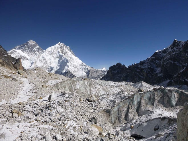 Himalayan glaciers are receding twice as fast now as they were at the end of last century. The peak at the left of this image is Mount Everest.