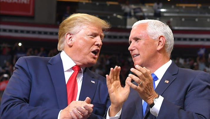 Vice President Mike Pence speaks with President Trump at a rally to officially launch the Trump 2020 campaign.