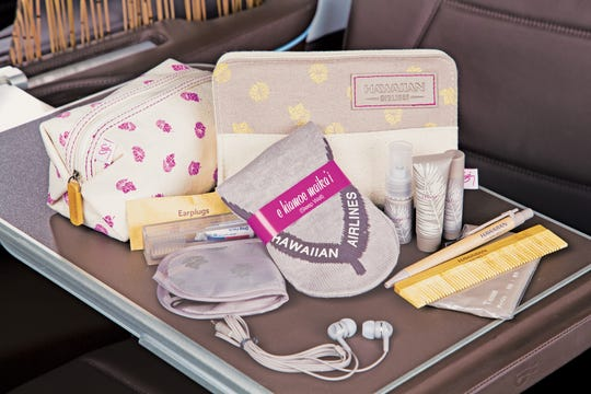 Hawaiian Airlines First Class amenity kits pictured left in photo