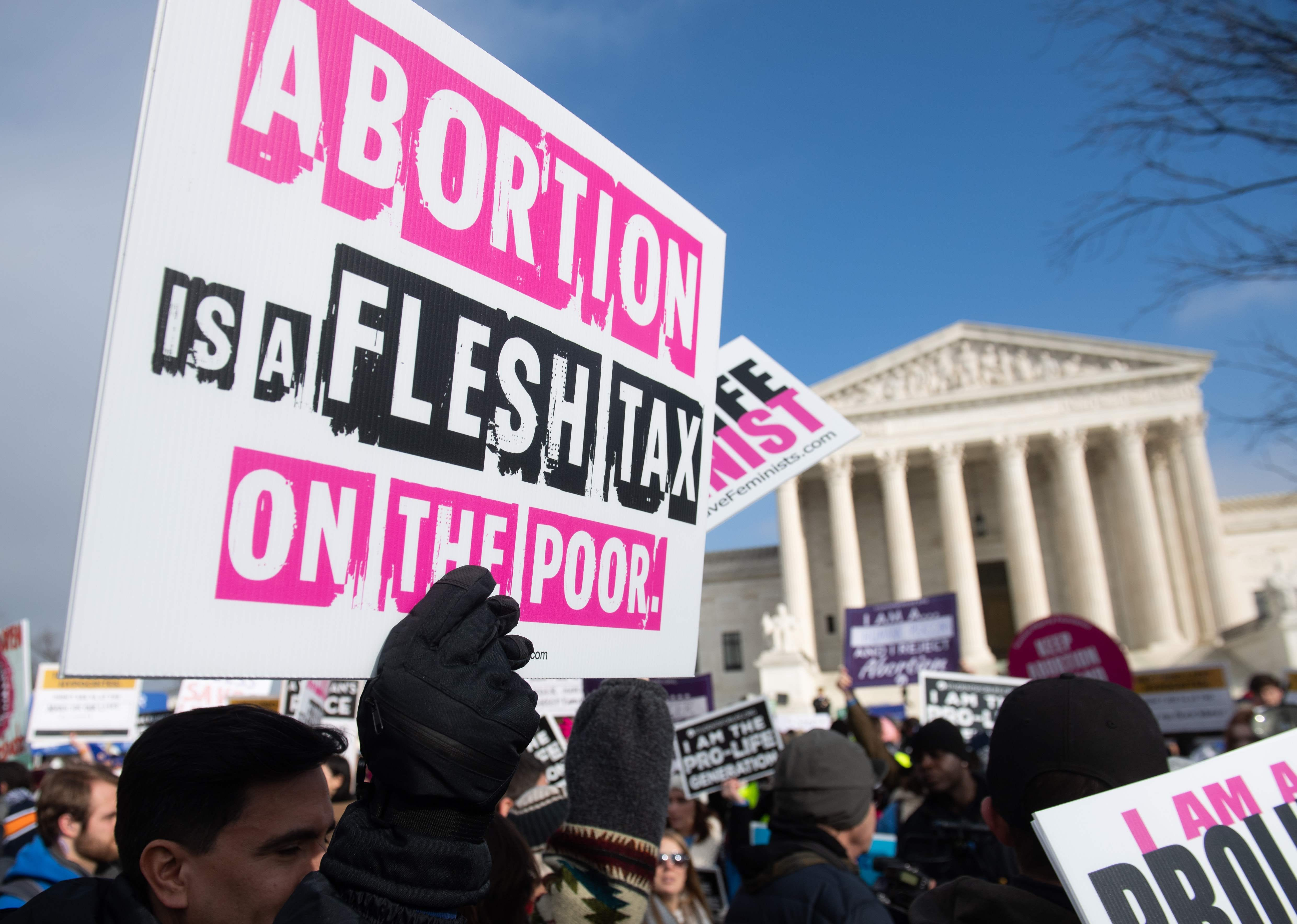 """Anti-abortion activists participate in the """"March for Life,"""" an annual event to mark the anniversary of the 1973 Supreme Court case Roe v. Wade, in front of the US Supreme Court, on January 18, 2019."""