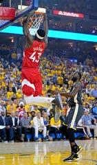 Raptors forward Pascal Siakam (43) dunks the ball against Warriors forward Draymond Green.
