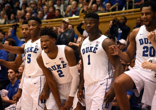 Duke Blue Devils forward R.J. Barrett (5), forward Cam Reddish (2) and forward Zion Williamson (1) react with teammates during the second half against the Princeton Tigers at Cameron Indoor Stadium.