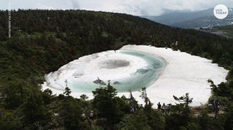 "The ""Dragon Eye"" pond at the foot of Mount Hachimantai in northern Japan looks like an eye."