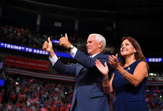 Vice President Mike Pence and his wife Karen Pence arrive at a rally for President Trump.