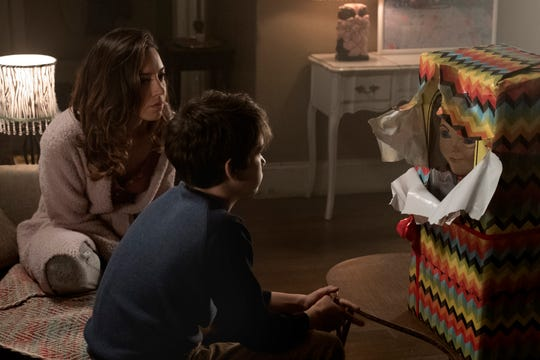 "Karen (Aubrey Plaza, left) gifts her son Andy (Gabriel Bateman) with an in-demand Buddi doll in ""Child's Play."""