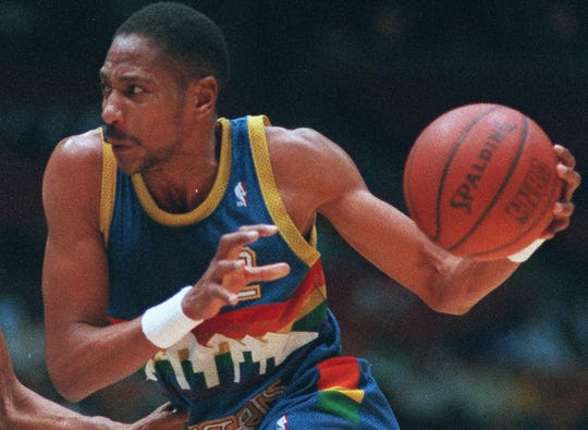 Alex English drives against Dudley Bradley in this Jan. 6, 1988 photo.