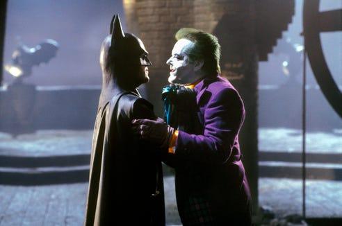 "Batman (Michael Keaton, left) and the Joker (Jack Nicholson) throw down in a memorable moment from 1989's ""Batman."""