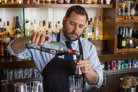 Neal Bodenheimer, a mixologist at Cure, a craft cocktail bar he opened in 2009 in New Orleans, prepares a cocktail.