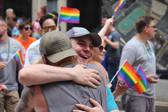 Scott Dittman gives a hug at the Pittsburgh Pride Parade.