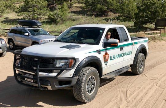 A  U.S. Park Ranger at Great Sand Dunes National Park & Preserve in southern Colorado patrols the Medano Creek Road, a backcountry area near the tallest sand Dunes in North America.