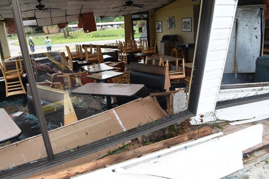 Dairy Queen on U.S. Highway 165 In Ball sustained major damage in Thursday's early morning storm. Ricky Richardson (front right) and his grandfather Bill Liberto, franchise owners, check out the damage. Richardson said he got a call early Thursday from an employee who said a friend had seen the damage while driving by. Richardson said they were grateful no one was inside the building during the storm and that it didn't happen during business hours.
