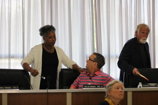 Rapides Parish School Board members (from left) Sandra Franklin speaks with President Wilton Barrios as Dr. Stephen Chapman takes his seat Wednesday.