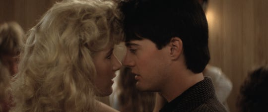 "Laura Dern, left, and Kyle MacLachlan in a scene from ""Blue Velvet."""