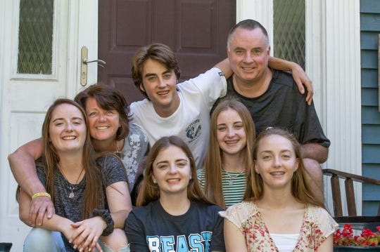 Toms River's Keogh quintuplets pictured last spring with parents Susan and Jim.
