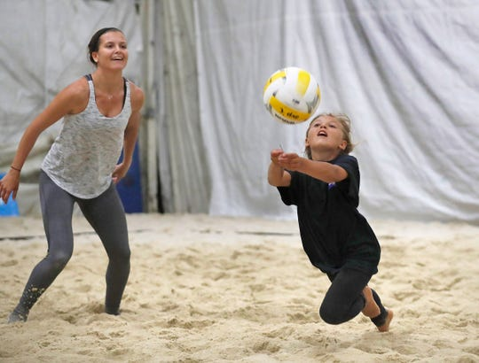 Ten-year-old Ali Lubach of Brick returns a shot as Veronica Corcoran of Closter looks on. Highline Arena has taken over the Tab Ramos Sports Center in Aberdeen, featuring six indoor beach volleyball courts and a roller hockey rink.