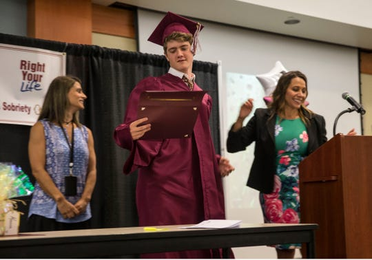 Jackson Croke of Shrewsbury accepts his diploma at K.E.Y.S. Academy's graduation ceremony.