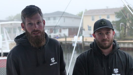 Jeff Crilly, left, and Ray Kerico talk about their encounter with a great white shark during a fishing competition off the coast of New Jersey.