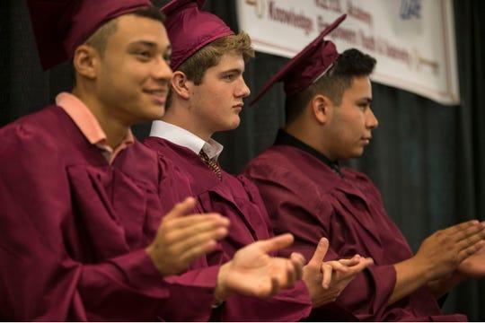 K.E.Y.S. Academy graduates (left to right) William Watson Cummings, Jackson W. Croke, and Juan Carlos Andrino Melendez enjoy Thursday's ceremony.