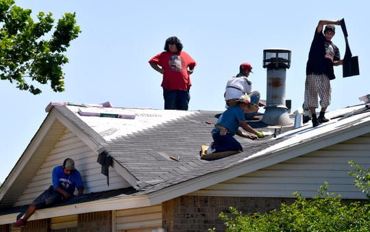 REPORTER-NEWS FILE PHOTO: Men work on a roof belonging to a home on Alameda Road in June in the same neighborhood struck by the May 18 tornado.