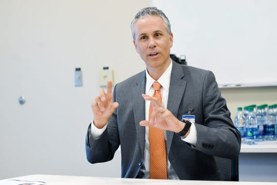 Greg Lowe, president of HCA Healthcare's North Carolina Division answers questions during a meet and greet with the media at the Mission Health SECU Cancer Center in Asheville on June 20, 2019.