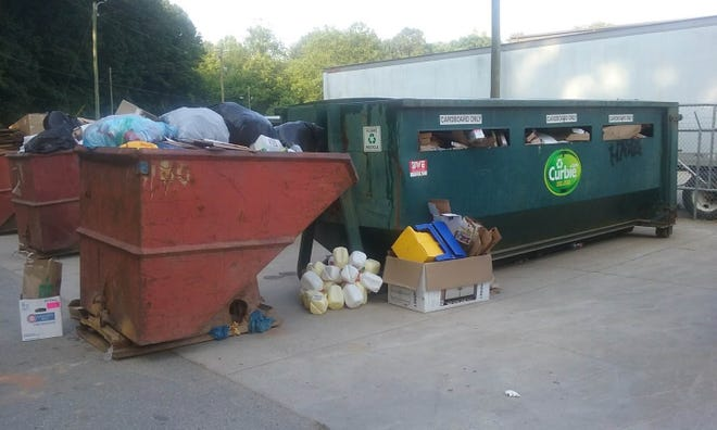 Curbside Management in Woodfin, which handles recycling for Asheville and other municipalities, acknowledges that a collection bin it operates has been overflowing recently. A truck used to move and empty the recycling bin broke and needed a new motor.