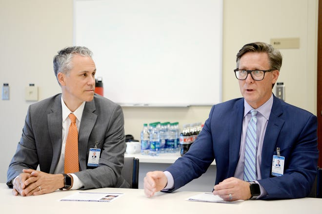 Greg Lowe, president of HCA Healthcare's North Carolina Division and Terrance van Arkel, North Carolina Division CFO, answer questions during a meet and greet with the media at the Mission Health SECU Cancer Center in Asheville on June 20, 2019.
