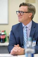 Terrance van Arkel, HCA Healthcare's North Carolina Division CFO, answers questions during a meet and greet with the media at the Mission Health SECU Cancer Center in Asheville on June 20, 2019.