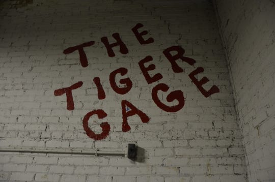 """The Tiger Room on West Van Buren Street in downtown Battle Creek used to be where St. Philip hosted its school dances and was home to """"The Tiger Cage,"""" where batting cages were for students to practice hitting."""