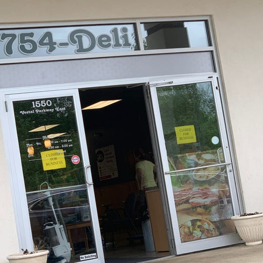 Full Belly Deli, located on 1550 Vestal Parkway East, contains signs readying 'closed for business.'