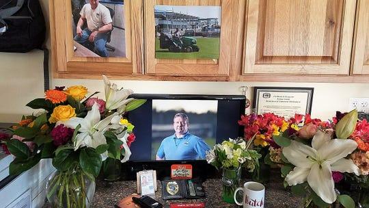 A shrine is set up at the desk of Steve von Marenholtz at the Port of Kingston. Von Marenholtz died in Wildcat Lake earlier this week.