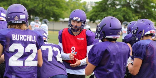 North Kitsap quarterback Colton Bower breaks huddle with his teammates during Wednesday's football scrimmage against Central Kitsap in Poulsbo.