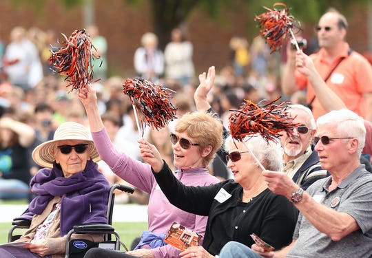 "Harriet E. (Sullivan) Morton, left, 99, looks on as fellow Central Kitsap High alumni shake their pompoms in the air during the ""95 years of excellence"" celebration at Central Kitsap High School in Silverdale on Thursday. Morton is one of CK High's oldest living alumni."