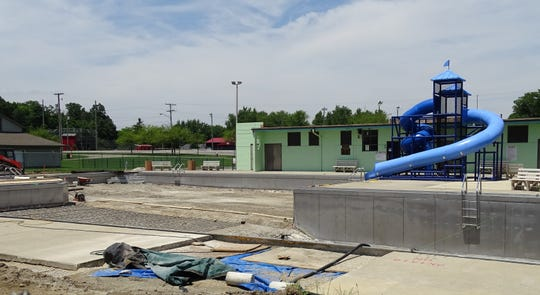 Work continued on the Aumiller Park pool under sunny skies in mid-June, but the rain returned the next day.