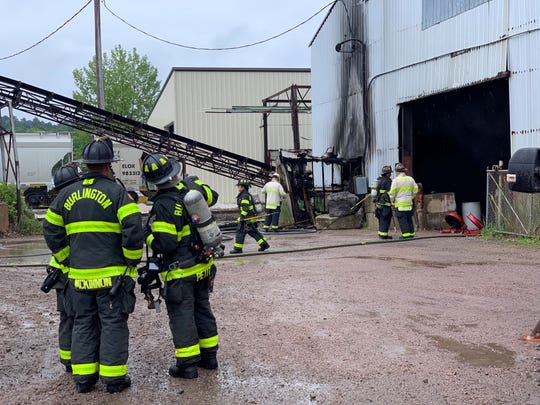 Burlington firefighters work to clear a salt shed in the Burlington rail yard after a fire erupted in the building Thursday afternoon, June 20, 2019. Deputy Chief Aaron Collette said no one was injured and the cause is currently under investigation.