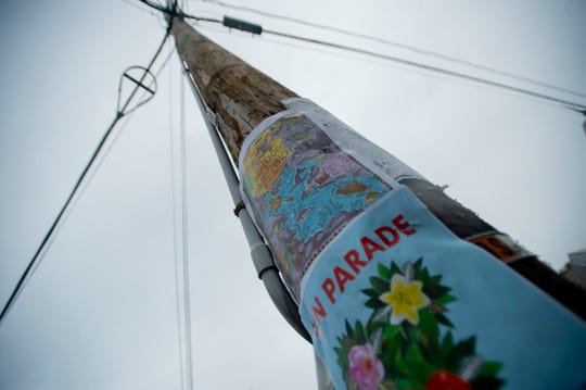 A utility pole on the corner of Loomis Street with signs on June 20, 2019.