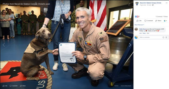 Finley Lewis, a service dog, was promoted to the rank of lieutenant commander during a ceremony at Naval Air Station - Corpus Christi on Thursday, June 20, 2019. He was given a certificate and signed it with his paw print.