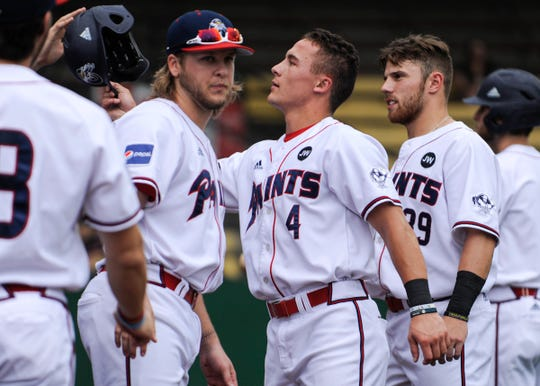 Paints infielder Gavin Homer celebrates with teammates in a 2-1 win over West Virginia on June 19, 2019. Homer hit a three-run home run in a 3-2 win over the Terre Haute Rex on Saturday.