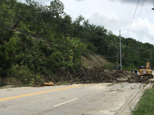 JUNE 20, 2019 WILDER, KY: A Kentucky highway work crew continues to clear a landslide that covered all four lanes of Ky. 9 after early Sunday morning storms.