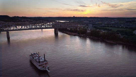 Thurs., June 8, 2017: A riverboat makes its way down the Ohio River between Cincinnati, Ohio and Covington, Kentucky at sunset. (Sam Greene & Carrie Cochran/ USA Today Network)