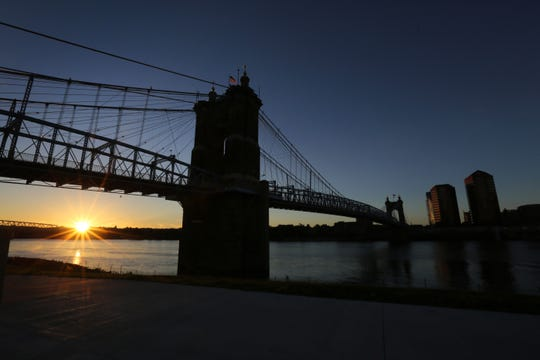 October 5, 2015: The John A. Roebling Suspension Bridge at sunrise, shot from Smale River Front Park, looking into Covington.