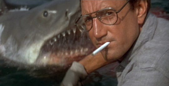 "Roy Scheider is about to meet his marine nemesis - and learn that he'll need a bigger boat - in a scene from the 1975 Steven Spielberg film ""Jaws,"" the first summer blockbuster."