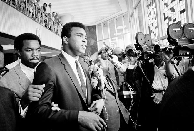 Muhammad Ali was convicted of draft evasion - and immediately stripped of his heavyweight title - in 1967, after refusing to be inducted into the U.S. Army, citing religious reasons. His conviction was later overturned.