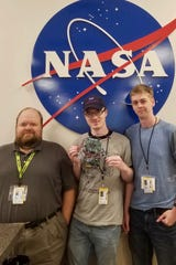 From the left are Dr. Justin Oelgoetz, Zach Hill and Zach Givens.