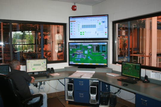 A Gas & Water Department technician uses computers to monitor water operations at the Clarksville Water Plant.