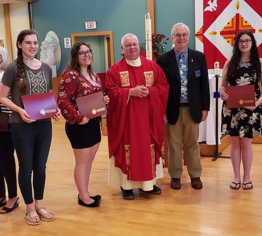 (Left to right) Kelly Fraine, Gwendolyn King, Rev. Richard Rusk Pastor, St. John Neumann Church, Knight Steve Bauernfeind and Mia Ranallo